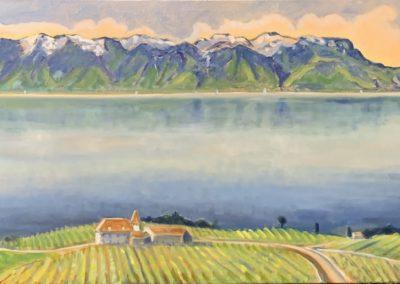 Ce tableau présente une vue panoramique depuis le haut de Lavaux, avec le reflet sur le lac Léman et le Grammont, ainsi que les vignes en arrière plan.